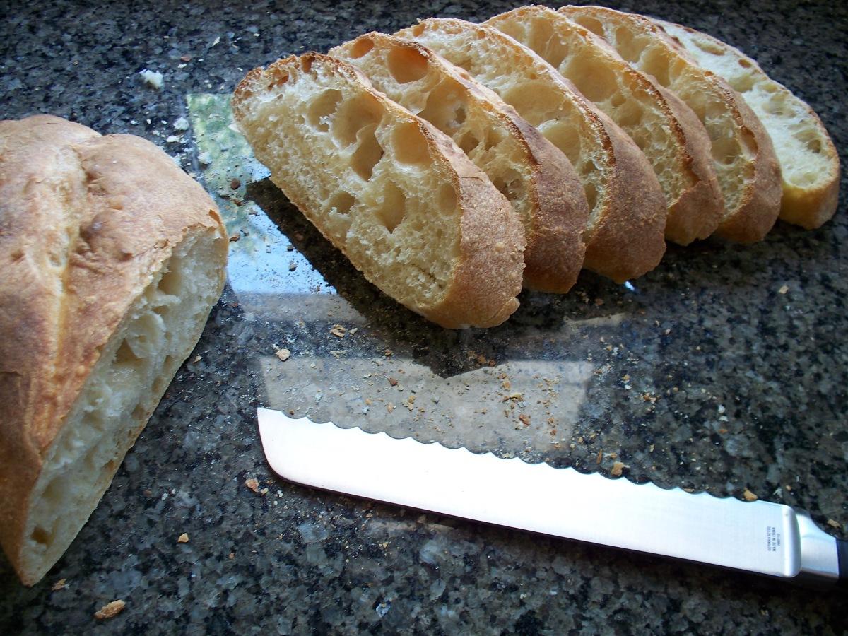 Slicing Rustic Bread Loaf