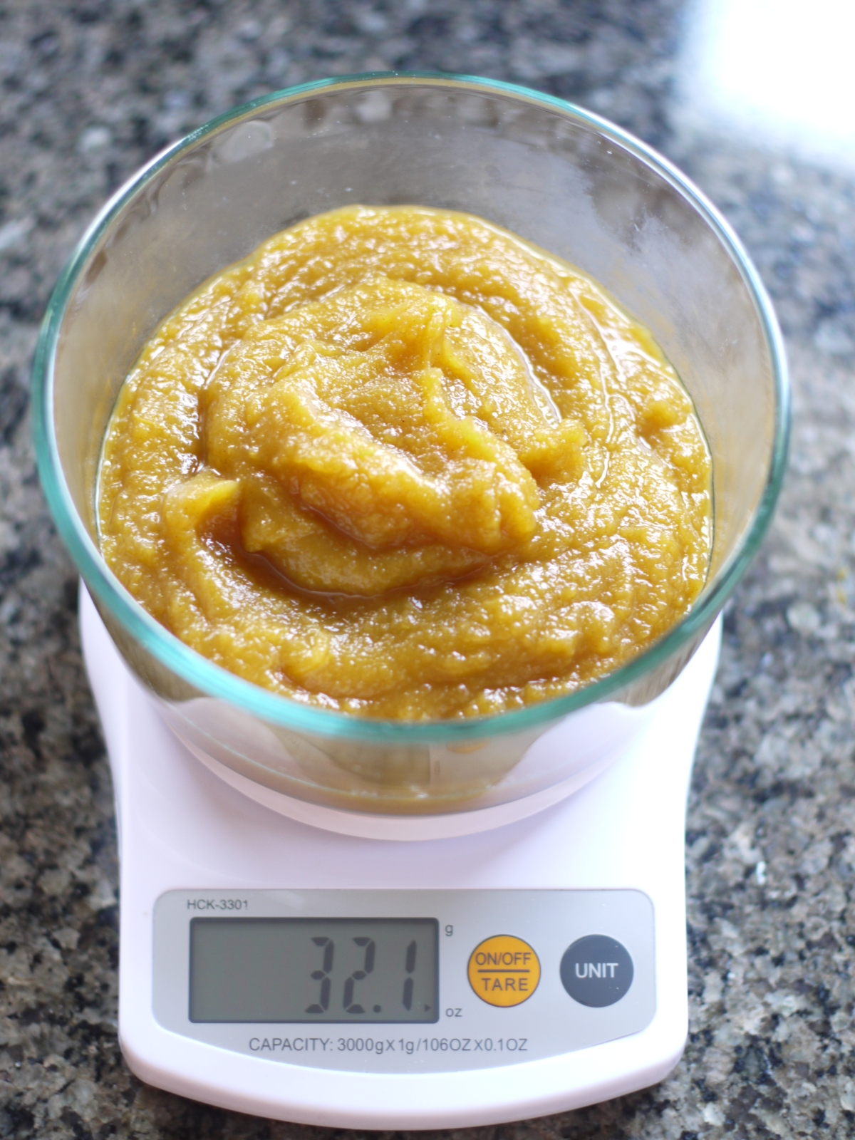weighing out pumpkin puree