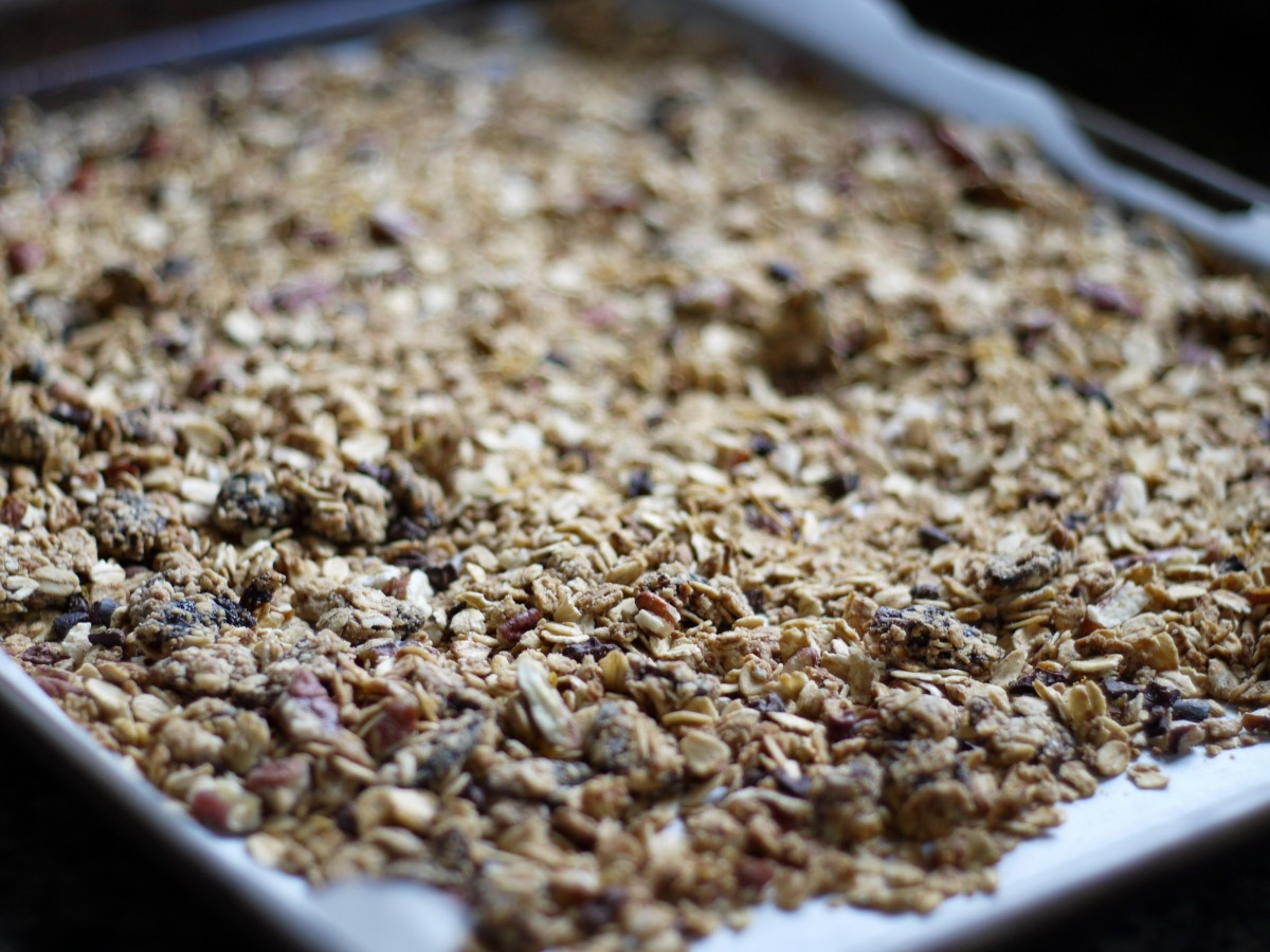 baked granola on baking sheet